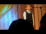Фрагмент концерта в день Сретения Господня. Восьмилетний мальчик (Влад Осетров) поёт песню об Архангеле Михаиле. Село Новенькое Белгородской области